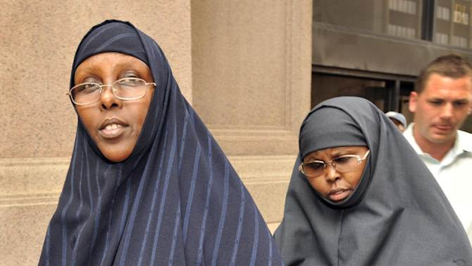 FILE - In this Aug. 5, 2010 file photo, Hawo Mohamed Hassan, left, and Amina Farah Ali, both of Rochester, Minn., leave U.S. District Court in St Paul, Minn. The two Minnesota women, convicted of conspiring to send money to al-Shabab in Somalia, were sentenced Thursday, May 16, 2013. Ali, 36, was sentenced to 20 years in prison on 13 terrorism-related counts, and Hassan, 66, received a 10-year term on one terror-related count and two counts of lying to the FBI. (AP Photo/Craig Lassig, File)