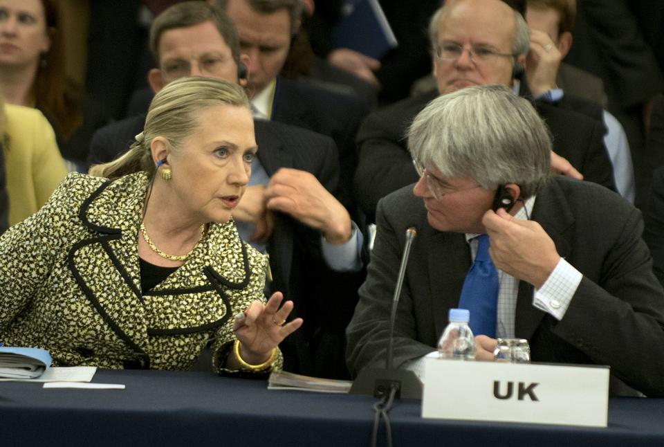 U.S. Secretary of State Hillary Rodham Clinton speaks with Britain's International Development Secretary Andrew Mitchell  before a plenary session of an international conference on Afghan civilian assistance at a hotel in Tokyo Sunday, July 8, 2012. (AP Photo/Brendan Smialowski, Pool)