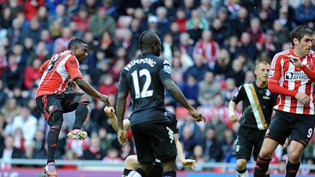 Stephane Sessegnon, left, scores Sunderland's equaliser in the second half against Fulham