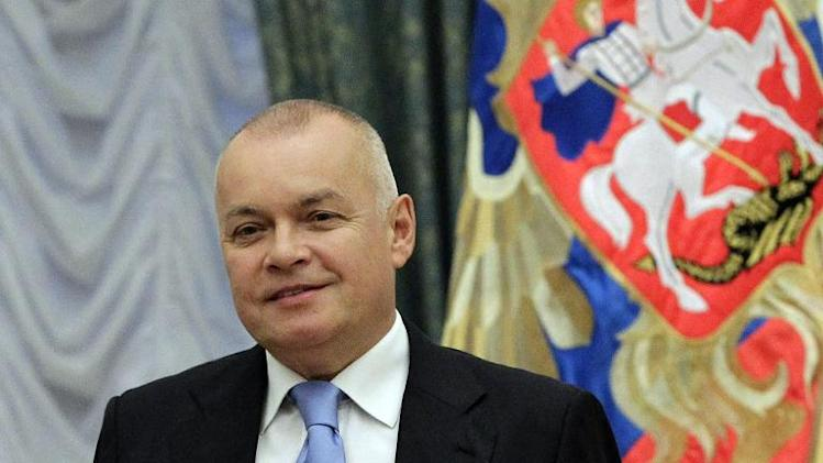 A picture taken on October 10, 2011, shows Russian television journalist Dmitry Kiselyov posing for a photo after receiving a medal of Friendship during an awarding ceremony in the Kremlin in Moscow