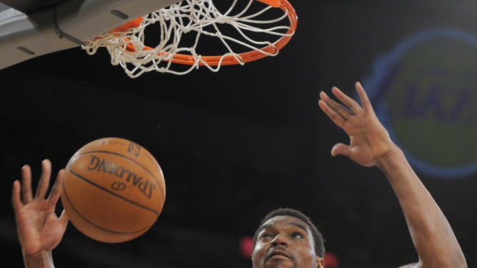 Los Angeles Lakers center Andrew Bynum dunks during the first half in Game 5 of an NBA first-round playoff basketball game against the Denver Nuggets, Tuesday, May 8, 2012, in Los Angeles. (AP Photo/Mark J. Terrill)