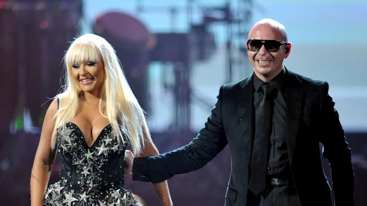 Christina Aguilera, left, and Pitbull perform at the 40th Anniversary American Music Awards on Sunday, Nov. 18, 2012, in Los Angeles. (Photo by John Shearer/Invision/AP)
