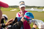 TAIPEI, TAIWAN - DECEMBER 05: Jessica Korda of the USA, signs hats during the Celebrity Charity Swining Skirts Skins Day, at Miramar Golf & Country Club on December 5, 2013 in Taipei, Taiwan. (Photo by Gareth Gay/Getty Images)