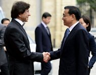 Belgian Prime Minister Elio Di Rupo (L) and Chinese Vice-Prime Minister Li Keqiang (R) shake hands at The Egmont Palace in Brussels. China and Belgium set up an investment fund to pump more Chinese money into leading European firms Wednesday during a visit by Keqiang