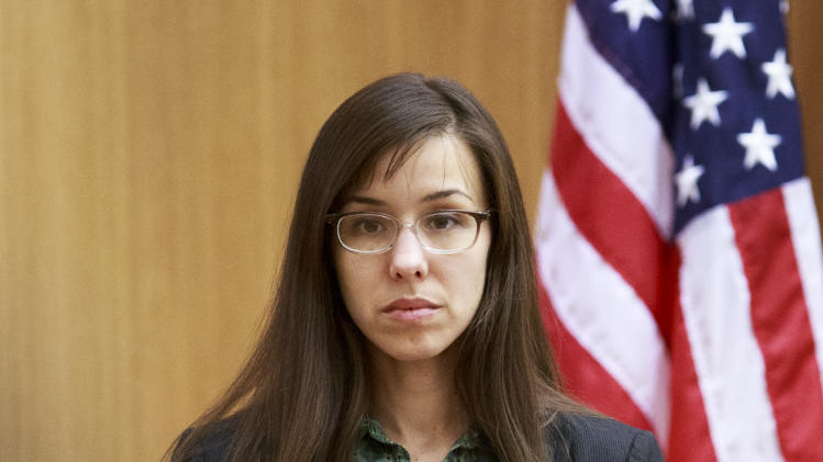 Defendant Jodi Arias prepares to testify on the witness stand during her murder trial in Judge Sherry Stephens Superior Court, on Wednesday, Feb. 6, 2013.  Arias, 32, is accused of stabbing and slashing Alexander, 27 times, slitting his throat and shooting him in the head in his suburban Phoenix home in June 2008. She initially denied any involvement, then later blamed it on masked intruders before eventually settling on self-defense.  (AP Photo/The Arizona Republic, Charlie Leight)