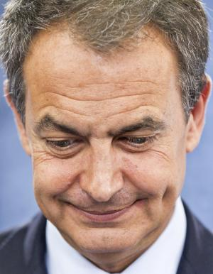 Spain's Prime Minister Jose Luis Rodriguez Zapatero looks down during a press conference at the Moncloa Palace, in Madrid, Friday, July 29, 2011. Zapatero announced early general elections in November, scheduling the race four months earlier than anticipated.(AP Photo/Daniel Ochoa de Olza)