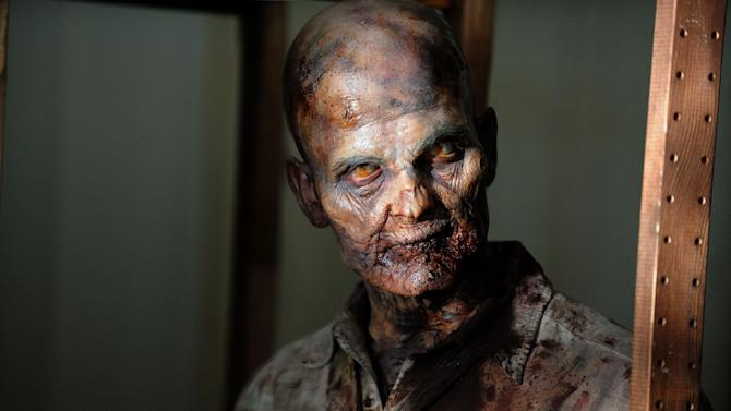 """This undated publicity photo provided by AMC shows a zombie in a scene from AMC's TV show, """"The Walking Dead,"""" Season 3, Episode 1. The show airs Sundays at 9 p.m. EST on AMC. (AP Photo/AMC, Gene Page)"""