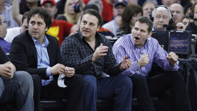 FILE - In this Feb. 28, 2011 file photo, Sacramento Kings owners George, Gavin and Joe Maloof, left to right, cheer on their team against the Los Angeles Clippers during the second half of an NBA basketball game in Sacramento, Calif. The city of Sacramento, the NBA and the Kings have announced a tentative deal to finance a new arena that would keep the team in California's capital. Sacramento Mayor Kevin Johnson, NBA Commissioner David Stern and the Maloof family, which owns the Kings, announced Monday in Orlando, Fla.,  that an agreement had been reached. (AP Photo/Steve Yeater, file)