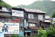 Older, shack-like buildings in the city of Yubari on Japan&#39;s northern island of Hokkaido in July 2012. What was once a town of nearly 117,000 people now has a population of just 10,400, spread out over 763 square kilometres (305 square miles)