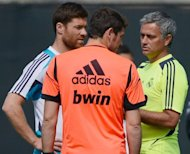 "Jose Mourinho (right) speaks with goalkeeper Iker Casillas (centre) and midfielder Xabi Alonso during a training session in Los Angeles, California, on August 1. Last season Mourinho became the first coach to win Spanish, Italian and English titles leading him to suggest a change to the nickname given to him in Britain -- ""the special one"""