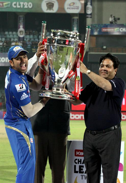 Mumbai Indians captain Rohit sharma with the CLT20 trophy after wining the final between Rajasthan Royals and Mumbai Indians at Feroz Shah Kotla stadium, in Delhi on Oct. 6, 2013. (Photo: IANS)