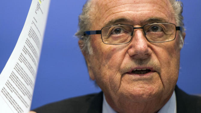 FIFA President Sepp Blatter speaks to journalists following the FIFA Executive Committee meeting in Zurich, Switzerland, Friday, Oct. 4, 2013. Blatter said a final decision on which months to play the 2022 World Cup in Qatar might be delayed until 2015. (AP Photo/Keystone, Ennio Leanza)