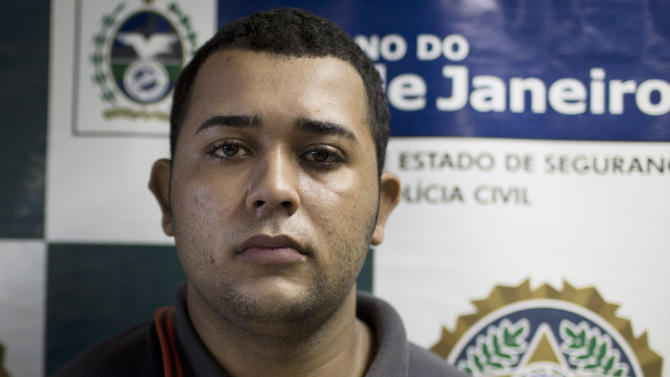 Jonathan Foudakis de Souza is presented to the press at Special Police Unit for Tourism Support (DEAT) after being arrested for allegedly attacking tourists in Rio de Janeiro, Brazil, Tuesday, April 2, 2013. An American woman was gang raped and beaten aboard a public transport van while her French boyfriend was shackled, hit with a crowbar and forced to watch the attacks after the pair boarded the vehicle in Rio de Janeiro's showcase Copacabana beach neighborhood, police said.  The attacks took place over six hours starting shortly after midnight on Saturday. (AP Photo/Felipe Dana)
