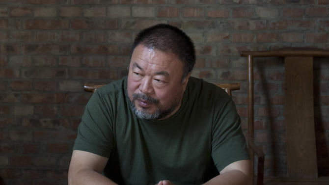 FILE - In this May 22, 2013 file photo, Chinese artist Ai Weiwei speaks to journalists at his studio in Beijing, China. The Chinese dissident artist says he was misled in lending his name and image to an independent science-fiction film that sought to raise funds on the Kickstarter website. (AP Photo/Alexander F. Yuan, File)