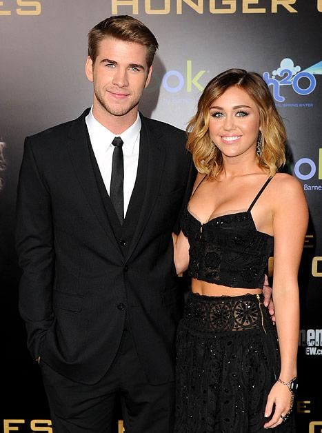 "Liam Hemsworth's Fiancee Miley Cyrus Is ""Team Katniss"""