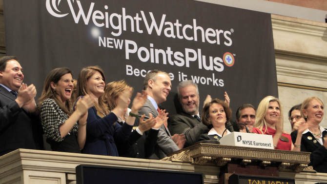 Weight Watchers International President and CEO David Kirchhoff, left center, rings the first opening bell of the year of the New York Stock Exchange Monday, Jan. 3, 2011. (AP Photo/Richard Drew)