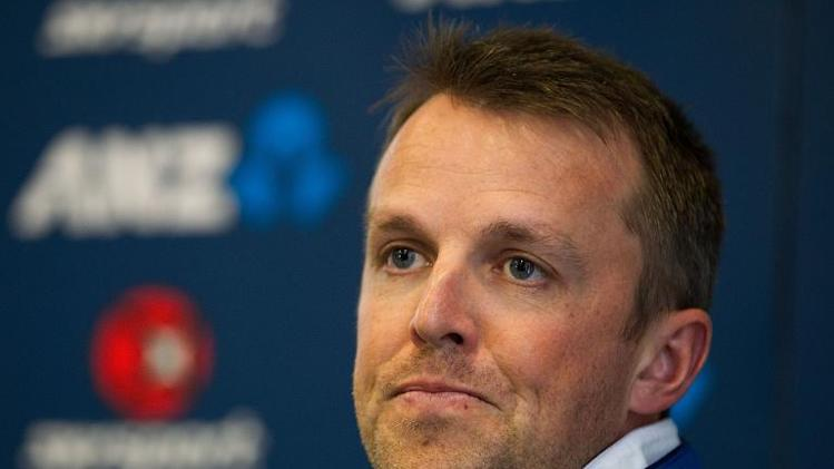 England spinner Graeme Swann talks to the media about his injured elbow after a Test match against New Zealand in Dunedin on March 6, 2013
