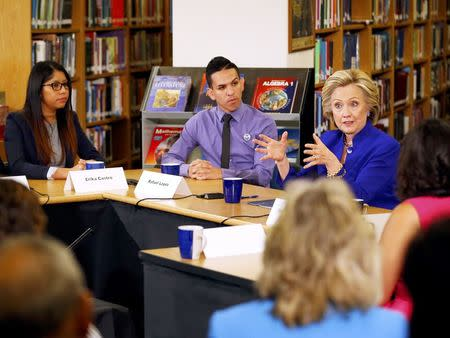 Clinton courts Latinos in Nevada, urges path to citizenship