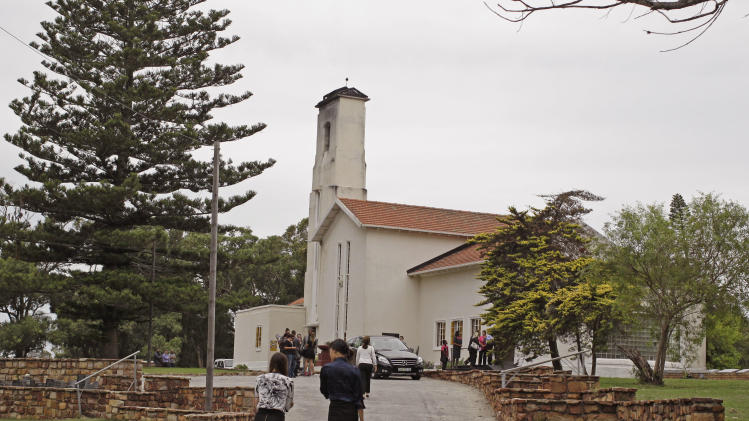 People arrive for the funeral of Reeva Steenkamp in Port Elizabeth, South Africa, Tuesday, Feb. 19, 2013. Olympic athlete Oscar Pistorius is charged with the premeditated murder of Steenkamp on Valentine's Day. The defense lawyer says it was an accidental shooting. (AP Photo/Schalk van Zuydam)
