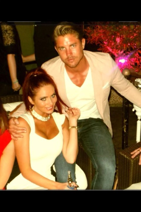 Celebrity Twitpics: Reality TV star Amy Childs shared some of her holiday snaps with Twitter followers this week. This one shows her cosying up to her boyfriend, David, on a night out in Dubai. Well j