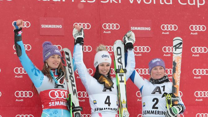 From left, second placed Slovenia's Tina Maze, first placed Austria's Anna Fenninger, and third placed France's Tessa Worley celebrate on the podium at the end of an alpine ski, women's World Cup giant slalom in Semmering, Austria, Friday, Dec. 28, 2012. (AP Photo/Pier Marco Tacca)