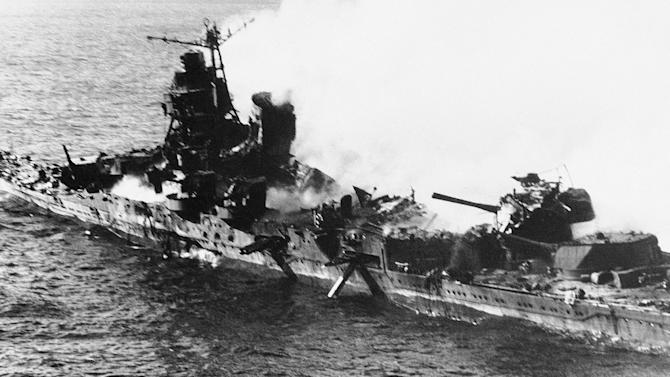 FILE - In this June 1942 file photo, a Mogami class Japanese cruiser is the flaming target of carrier-based U.S. naval aircraft in the historic battle of Midway which raged for three days in June 1942. On Monday, June 4, 2012, the Navy marks the 70th anniversary of a battle that turned the tide of World War II. (AP Photo, file)