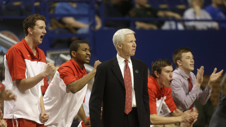 CORRECTS TO FIRST HALF NOT SECOND HALF AND REMOVES SCORE - Davidson head coach Bob McKillop, left, looks on as his players react on the bench during the first half of their second-round NCAA college basketball tournament game against Marquette, Thursday, March 21, 2013, in Lexington, Ky. (AP Photo/John Bazemore