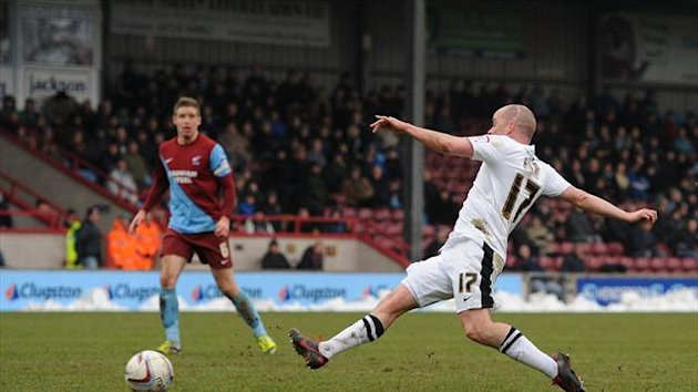 Iain Hume, right, scores table-topping Doncaster's second goal to help them extend their lead