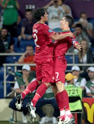 Cristiano Ronaldo (right) celebrates his winning goal with Bruno Alves