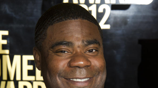 FILE - In this April 28, 2012, file photo, Tracy Morgan attends The Comedy Awards in New York. Morgan is suing Wal-Mart over the June 7, 2014, highway crash that seriously injured him and killed a fellow comedian. The lawsuit, filed Thursday, July 10, 2014, in U.S. District Court in New Jersey, claims Wal-Mart was negligent when a driver of one of its tractor-trailers rammed into Morgan's limousine. (AP Photo/Charles Sykes, File)