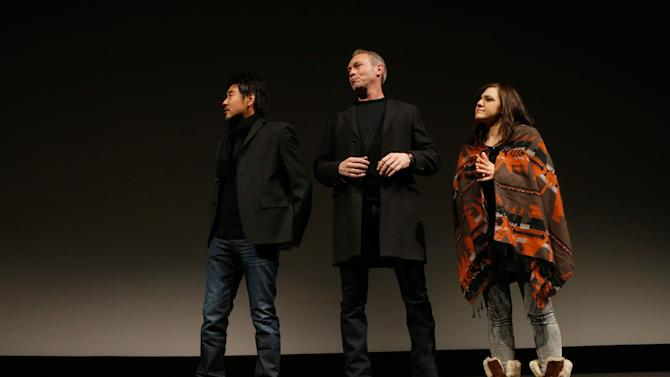 "From left, Cinematographer Chung-hoon Chung, producer Michael Costigan and composer Emily Wells speak onstage at attends Fox Searchlight's ""The Stoker"" premiere during Sundance Film Festival on Sunday, Jan. 20, 2012 in Park City, Utah. (Photo by Todd Williamson /Invision for Fox Searchlight/AP Images)"