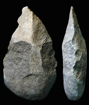 This undated photo provided by the National Center of Scientific Research shows ancient hand axes unearthed at an archaeological site at Lake Turkana in Kenya. A study published in the journal Nature suggests that ancient humans were using hand axes, cleavers and picks about 1.76 million years ago, much earlier than previously believed. (AP Photo/National Center of Scientific Research, Pierre-Jean Texier)