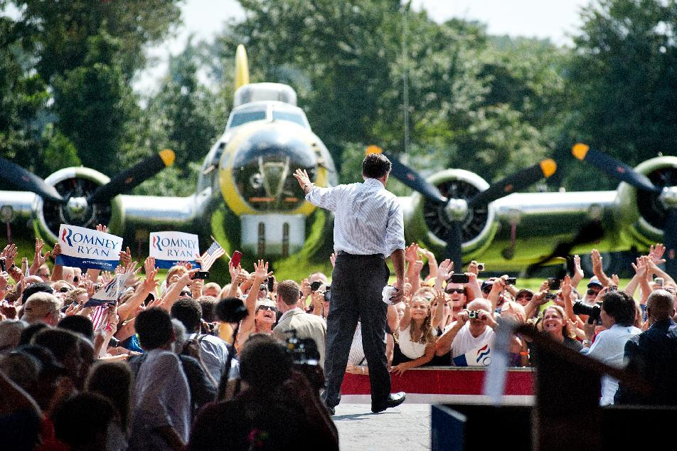 Republican presidential nominee Mitt Romney bids farewell to the audience after campaigning at the Military Aviation Museum in Virginia Beach, Va, Saturday, September 8, 2012.  (AP Photo/Rich-Joseph Facun)