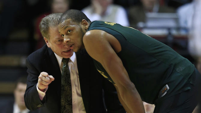 Michigan State head coach Tom Izzo, left, talks with Adreian Payne during the second half of an NCAA college basketball game against Indiana, Sunday, Jan. 27, 2013, in Bloomington, Ind. Indiana defeated Michigan State 75-70. (AP Photo/Darron Cummings)