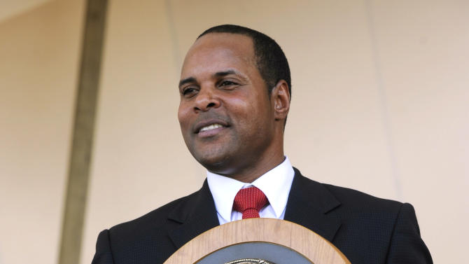 FILE - In this July 22, 2012, file photo, former Cincinnati Reds star Barry Larkin holds his plaque after his induction into the National Baseball Hall of Fame and Museum during a ceremony in Cooperstown, N.Y. Larkin wants to keep baseball's most exclusive club clean.  Inducted into the Hall of Fame last summer, he told The Associated Press in a phone interview Wednesday, Dec. 5, 2012, that players who cheat shouldn't receive baseball's highest individual honor. (AP Photo/Tim Roske, FIle)