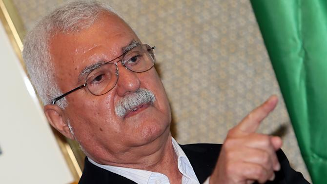 George Sabra, the new head of the main Syrian opposition bloc in exile, the Syrian National Council, speaks to reporters during a press conference on the sidelines of the General Assembly of the Syrian National Council meeting in Doha, Qatar, Saturday, Nov. 10, 2012. Sabra struck a combative tone Saturday, saying international inaction rather than divisions among anti-regime groups are to blame for the inability to end the bloodshed in Syria. (AP Photo/Osama Faisal)