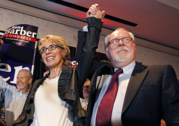 In an election to fill former Rep. Gabrielle Giffords, left, D-Ariz., congressional seat, Democratic candidate Ron Barber, right, celebrates a victory with Giffords and supporters at a post election e