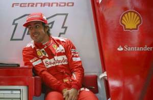 Ferrari Formula One driver Alonso of Spain looks on during final practice ahead of the British Grand Prix at the Silverstone Race Circuit