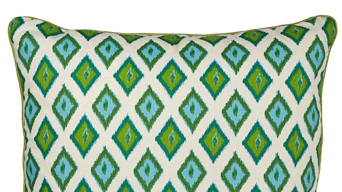 This undated publicity photo provided by Lamps Plus shows a Kite throw pillow in an emerald green ikat print, a good way to introduce one of spring's brightest new colors (www.lampsplus.com). (AP Photo/Lamps Plus)