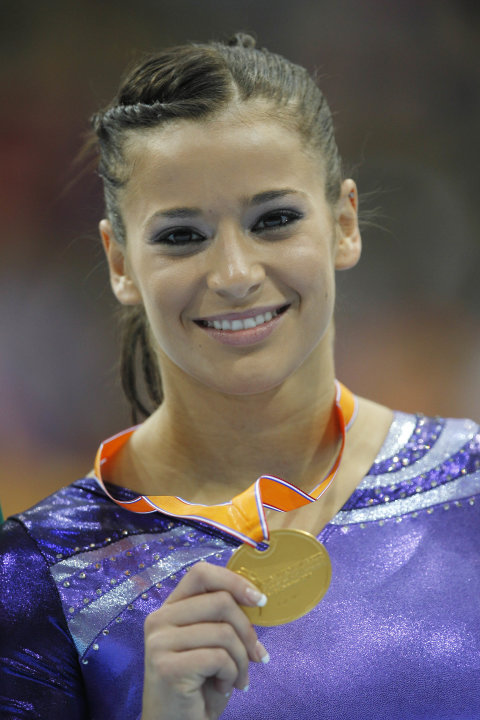 Alicia Sacramone of the U.S. shows her gold medal after winning the women's vault finalof the World Championships Gymnastics in Rotterdam, Netherlands, Saturday Oct. 23, 2010. (AP Photo/Bas Czerwinski