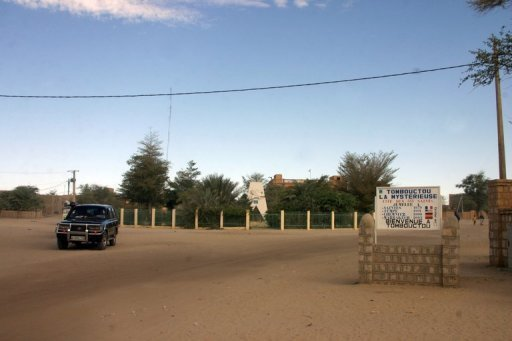 "<p>A sign reading ""Timbuktu the mysterious, Welcome to Timbuktu"" in a street of Timbuktu. Islamist militants in northern Mali on Monday destroyed the door of one of Timbuktu's three ancient mosques after destroying seven tombs of muslim saints over the weekend, witnesses say.</p>"