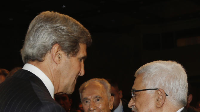 U.S. Secretary of State John Kerry, is joined by Palestinian President Mahmoud Abbas, right, and Israeli President Shimon Peres, center, as they participate in the World Economic Forum on the Middle East and North Africa at the King Hussein Convention Center at the Dead Sea in Jordan Sunday, May 26, 2013.  (AP Photo/Pool, Jim Young)