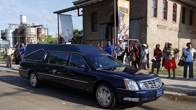 The hearse with the casket bearing the body of blues legend B.B. King leaves the B.B. King Museum and Delta Interpretive Center after a day of public viewing, Friday, May 29, 2015 in Indianola, Miss. The visitation comes a day before the funeral for the man who influenced generations of singers and guitarists. (AP Photo/Rogelio V. Solis)