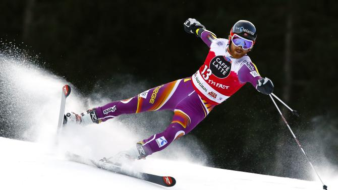 Haugen of Norway clears a gate during the men's World Cup Giant Slalom skiing race in Alta Badia