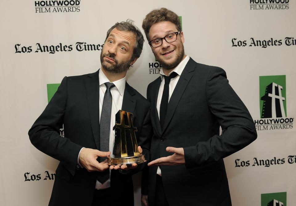 Judd Apatow, left, recipient of the Hollywood Comedy Award, poses with actor Seth Rogen backstage at the 16th Annual Hollywood Film Awards Gala on Monday, Oct. 22, 2012, in Beverly Hills, Calif. (Photo by Chris Pizzello/Invision/AP)