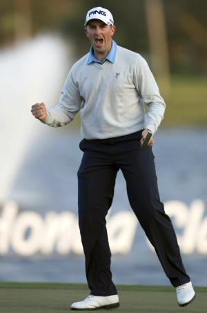 Michael Thompson reacts to winning the Honda Classic golf tournament, Sunday, March 3, 2013, in Palm Beach Gardens, Fla. Thompson closed with a 1-under 69, one of only five rounds under par on a punishing day at PGA National to finally become a PGA Tour winner. (AP Photo/Palm Beach Post, Allen Eyestone)  MAGS OUT; TV OUT; NO SALES
