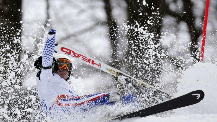 Russia's Aleksandr Akhmadulin crashes during the Men's Visually Standing Slalom event at the 2014 Sochi Paralympic Winter Games at the Rosa Khutor Alpine Center