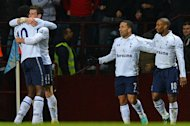 Tottenham Hotspur's Emmanuel Adebayor (L) congratulates Gareth Bale on scoring his second goal during their English Premier League match against Aston Villa at Villa Park in Birmingham, on December 26, 2012. Tottenham reavel to Sunderland next, on Saturday