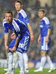 Chelsea's English defender John Terry (L) looks on during the UEFA Champions League semi-final first leg football match vs Barcelona at Stamford Bridge in London. Chelsea won 1-0