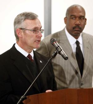 Ohio State football coach Jim Tressel, left, is flanked by athletic director Gene Smith during a news conference Tuesday, March 8, 2011, in Columbus, Ohio. Ohio State suspended Tressel for two games and fined him $250,000 for violating NCAA rules by failing to notify the school about information he received involving two players and questionable activities involving Buckeye memorabilia. Tressel also will receive a public reprimand and must make a public apology. (AP Photo/Terry Gilliam)